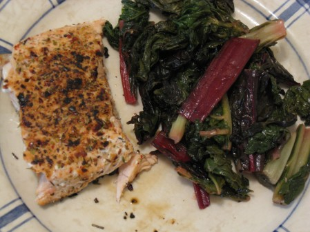 Blackened salmon with cajun spices and a side of swiss chard
