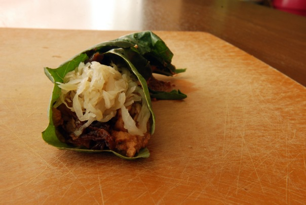 Reuben Collard Wrap with Sauerkraut, Caramelized Onions, Caraway Tempeh and Raw Thousand Island Dressing