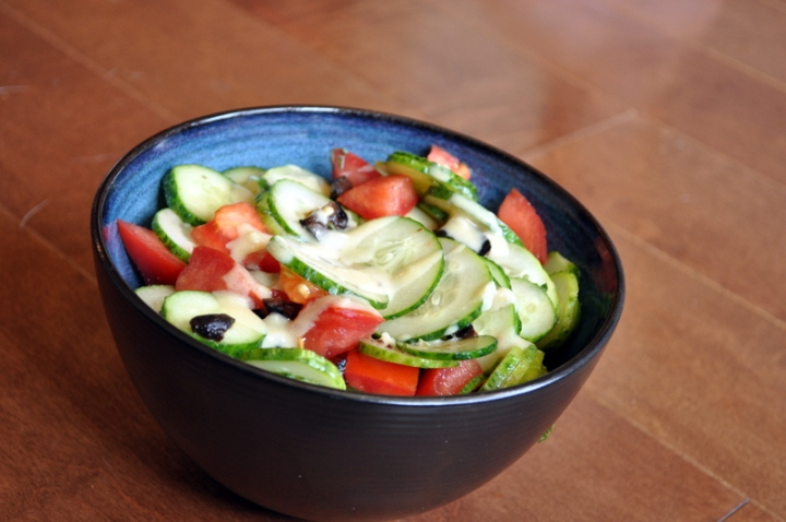 Cucumber and Tomato Salad with Garlic Tahini Dressing