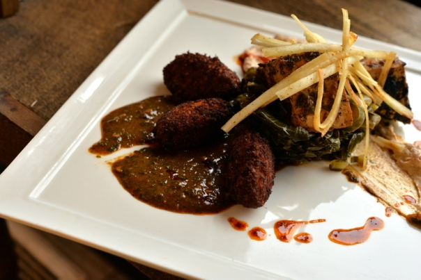 CHERMOULA TOFU - grilled spice rubbed chermoula tofu, braised jalapeños and collard greens, sweet potato quinoa hush puppies, crisp yucca strips, tangy almond cream sauce