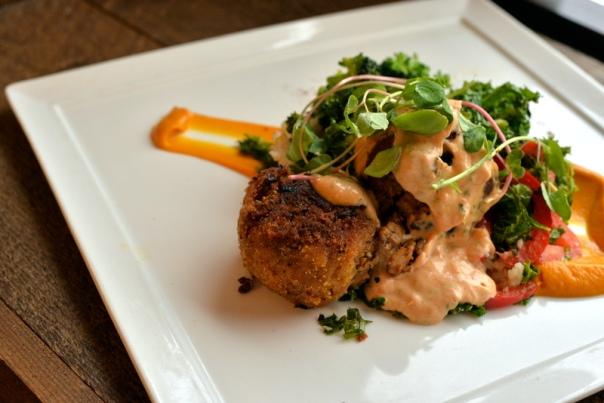TEMPEH CROQUETTES - crisp cornmeal and brown rice flour crust, roasted red pepper aioli, sweet potato puree, seasoned brown rice, sauteed herbed white wine garlic local veg